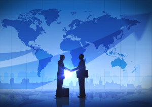 business-men-shaking-hands-map-background