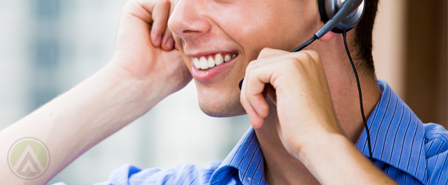 smiling-male-call-center-agent